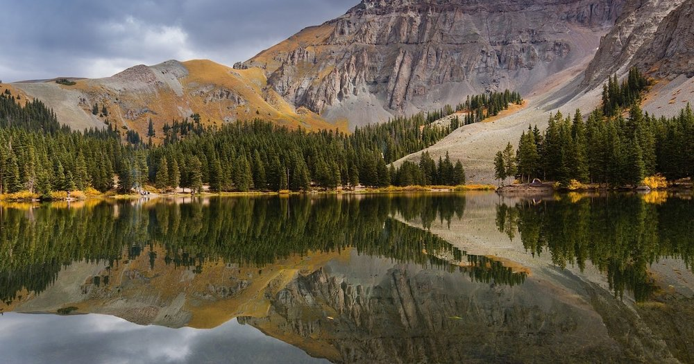 Conquer the world by hiking in the towering mountains of Alta Lakes.