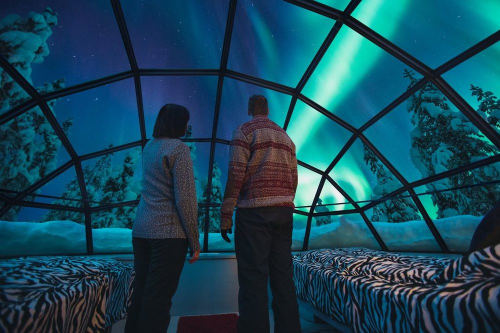 Take your Northern Lights sighting to the next level by staying at glass igloo in Finland.