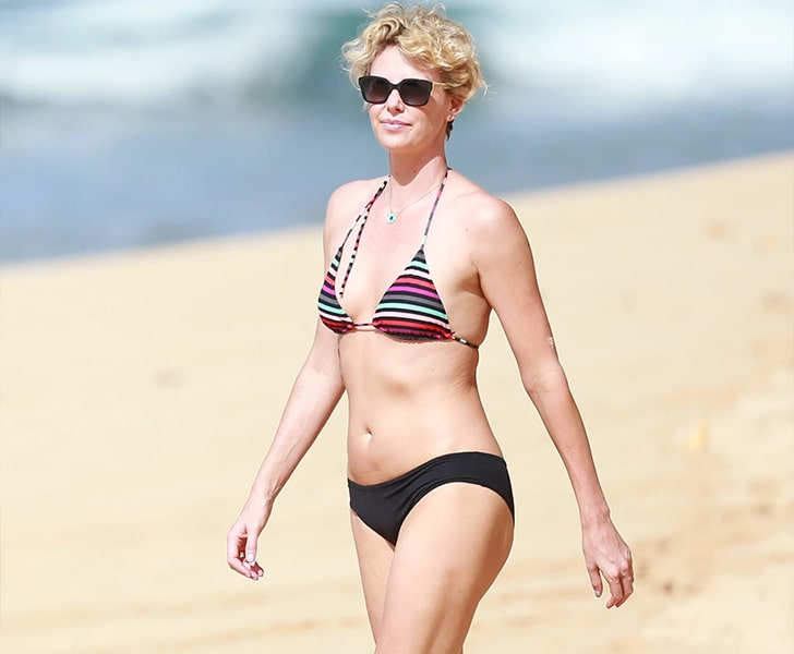 Charlize Theron – Gets A Good Tan In Hawaii